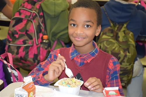 A student enjoys the school lunch program.