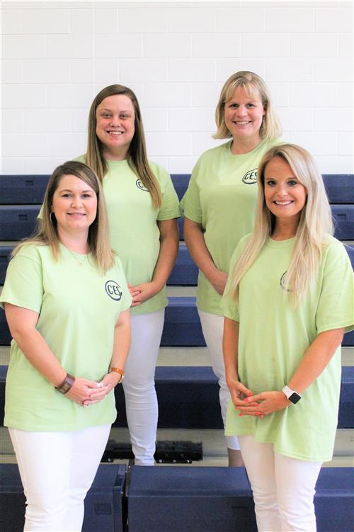 Four female third grade teachers posing