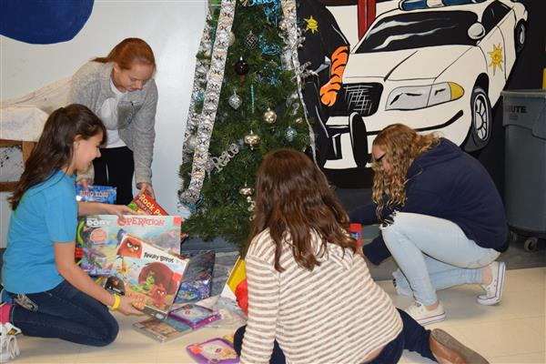 Stover Middle students look at some of the presents that have been donated to the school.