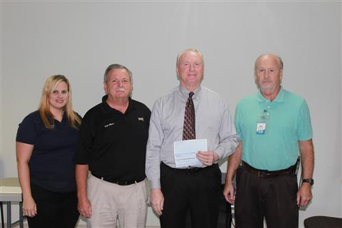 Sonic presents North Central Middle with reward check for highest participation in Fill A Bus