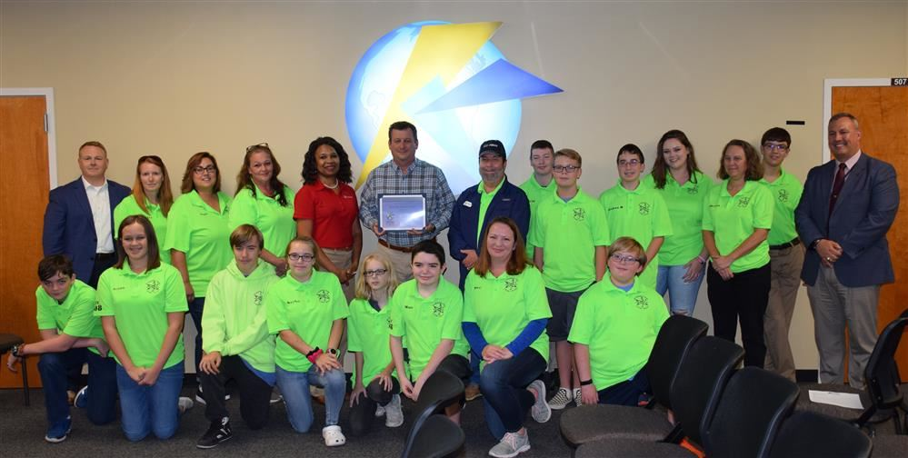 KC Robotics team accepts Invista donation