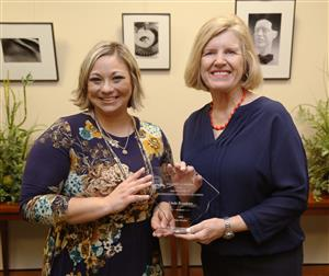 Branham (left) is recognized by State Superintendent Molly Spearman as a S.C. finalist...