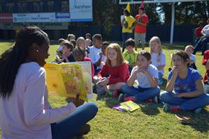 Camden High students read to elementary students during the first annual Kershaw County Read-In.