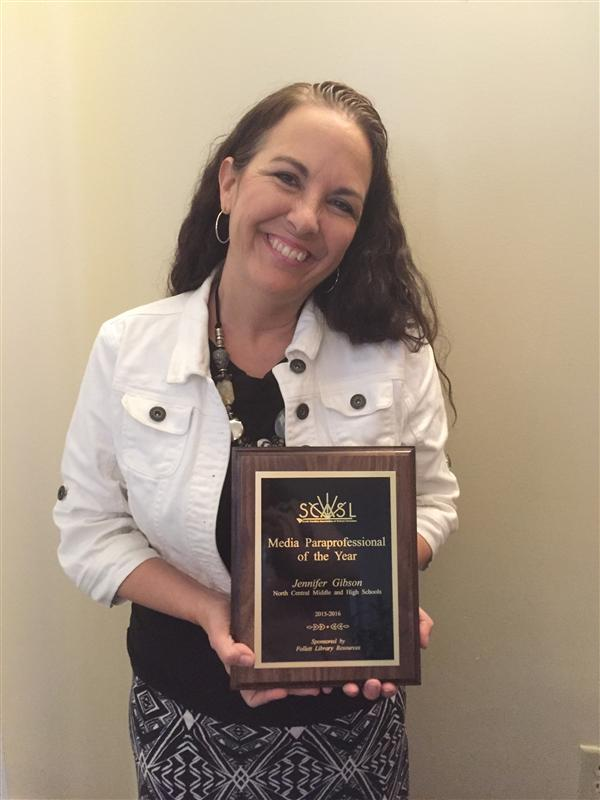 ​Jennifer Gibson displays her plaque recognizing her as SCASL's Media Paraprofessional of the Year.