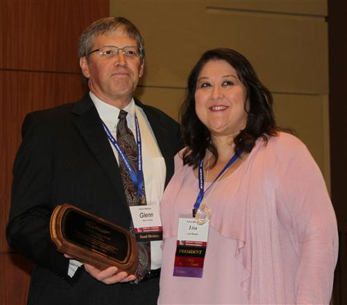 Price is honored for his selection in the SCMEA Hall of Fame by SCMEA President Lisa Rayner.