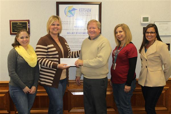 Teacher Forum members presented United Way of Kershaw County President Donny Supplee with a check f
